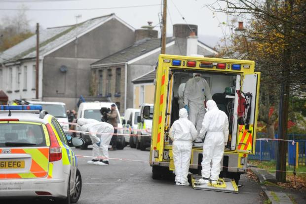 Police investigators at the  Sirhowy Arms Hotel where Williams was staying after his prison release.jpg