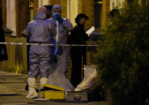 Armed plain clothes police raid an address in Willesden, North London, after a man was arrested outside parliament today2.jpg
