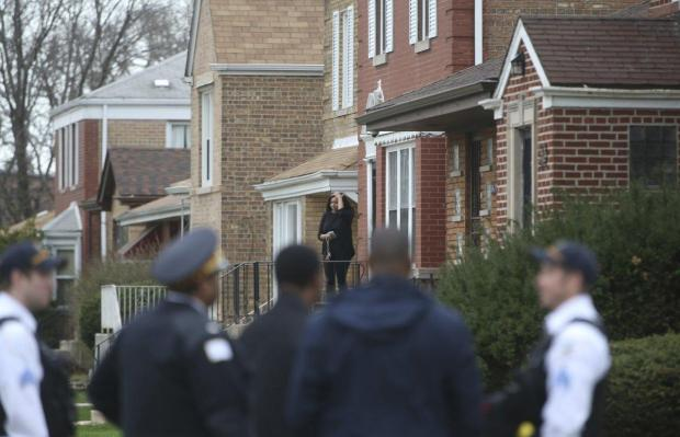 Cop activity outside  Judge Myles' home on the South Side of Chicago Monday morning after Myles was shot dead.jpg