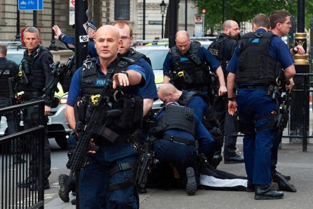 Cops swoop to arrest a terror suspect on Whitehall today2.jpg