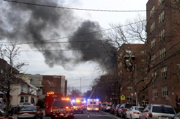 The 6:30 p.m. fire quickly spread through the building's cockloft between the upper ceiling and the roof, officials said. All 112 apartments were evacuated.jpg