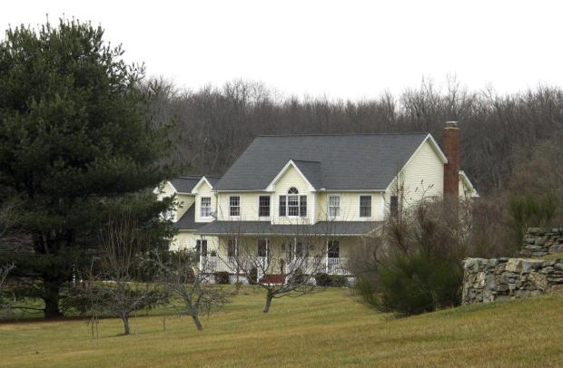 The Dabate home sits partially hidden by trees in Ellington, Conn1.jpg