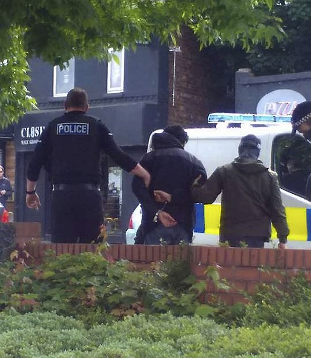 Armed police in Chorlton, Manchester arrested a man believed in connection with the terror attack at the Manchester Arena last night