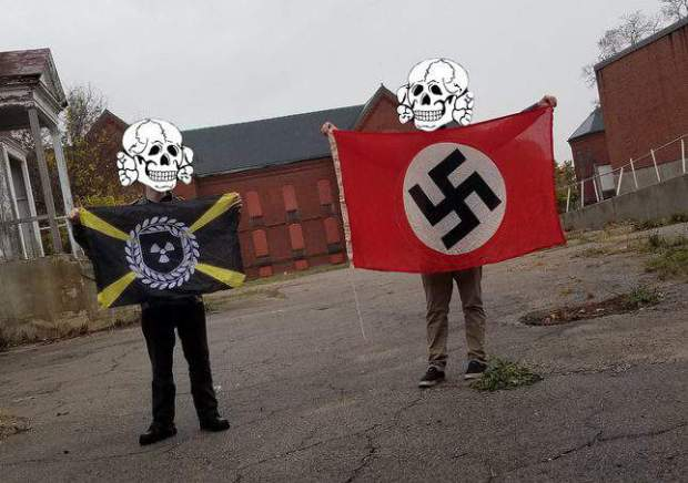 Brandon Russell and and alleged killer, Devon Arthurs with their faces covered, on a neo-Nazi message board in 2016.jpg