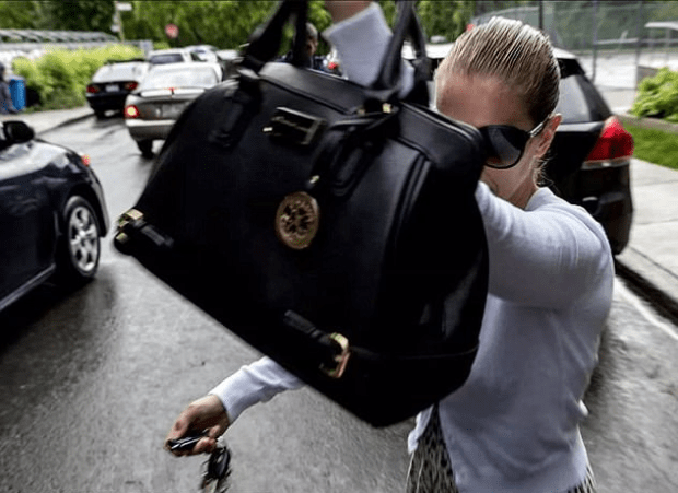Homolka dodged photographers outside the private Christian school this week
