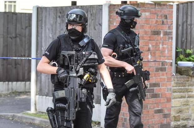SAS troops patrol as security chiefs say they are ready to counter any further terror threats.jpeg