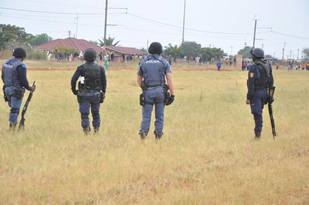 southafrica police confront protests white farms burn.jpg