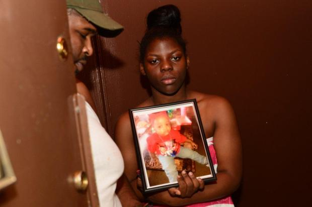 Little Nylah's aunt Christine Mumford, 13, holds photo of her niece.jpg