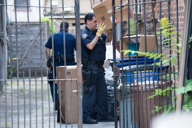 Police collect evidence from outside of the Park Slope crime scene, on Monday mrorning