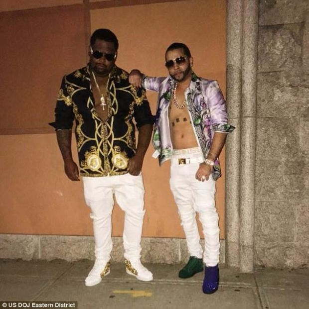 Alleged dealer Agosto [right], wearing an open shirt.jpg