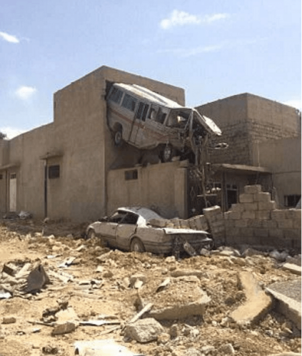 An elegant historic city now in ruins - Bomb damage in Mosul.png