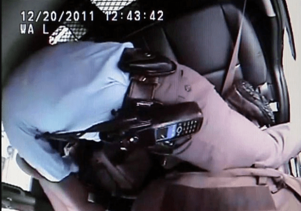 Jason Stockley reaching into a duffle bag in the back seat of the police SUV after fatally shooting Anthony Lamar Smith