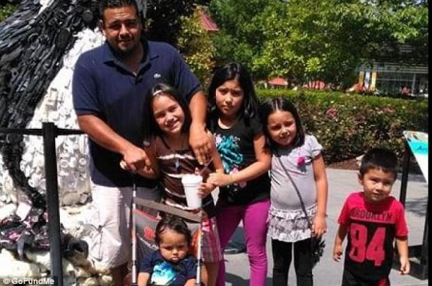 Martin Romero, 33, left, Diana Romero in front of Martin, survived.  The other children, from left to right are: Axel Romero, [in the stroller], Isabela Martinez, Dacota Romero, and Dillan Romero all died.jpg