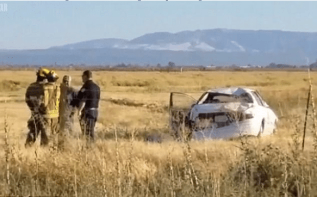 The car rolled over a barbed wire fence and onto a field in Los Banos, friday.png