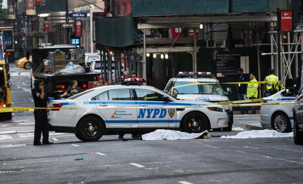 Their bodies lay covered under white sheets near the sidewalk on E. 33 St. as cops shut down much of the block to investigate the unusual double suicide