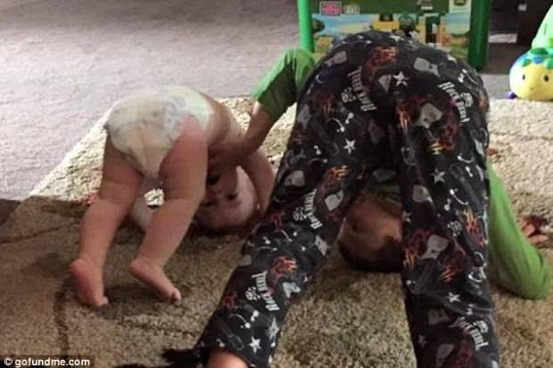 Cousins one-year-old Eli Sokolowiski and Clayton Chambers, 8, horsing around .jpg