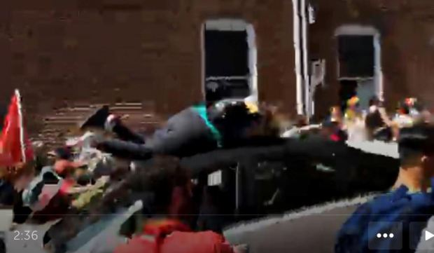 Dozens of people were in the street as the car sped toward them, the video shows