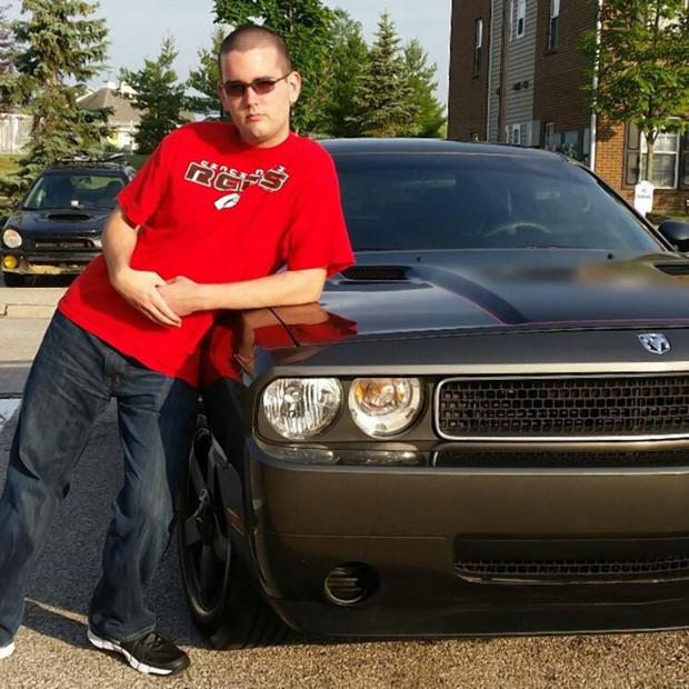 Fields poses with his Dodge Challenger on his Facebook page.jpg