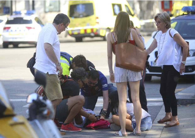 Injured woman receives treatment on the pavement from paramedics 1.png