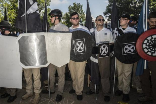 James Alex Fields Jr. (c.) brandished a shield from the Vanguard America group before the Charlottesville attack.