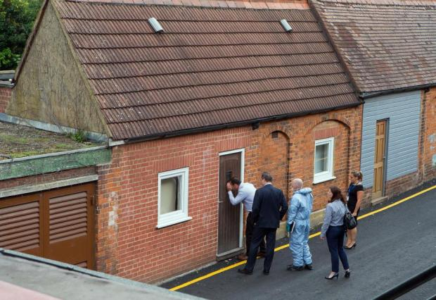 Police inspect the converted garage where Joshua is understood to have been living