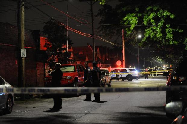 Police officesr at the scene of a fatal shooting on Staten Island, NY Aug 15.