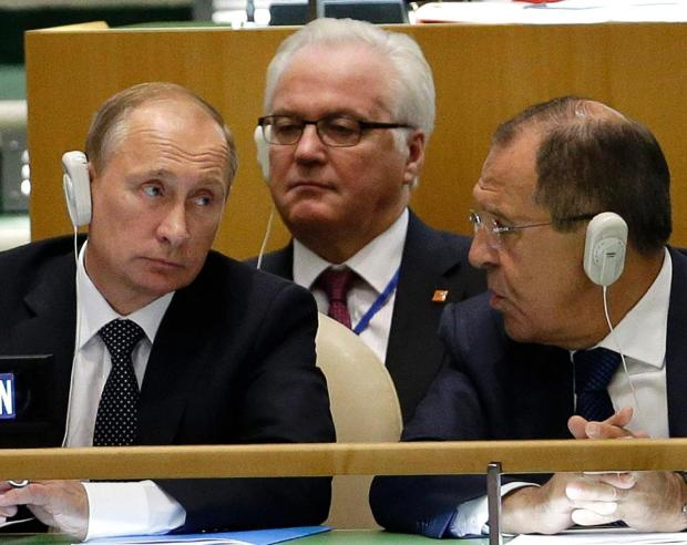 Russia's President Vladimir Putin, left, Foreign Minister Sergey Lavrov, right, and Ambassador to the United Nations Vitaly Churkin .jpg