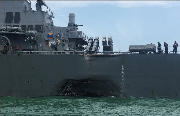 The guided-missile destroyer USS John S. McCain showing the hole in it's hull after the collision 3.png