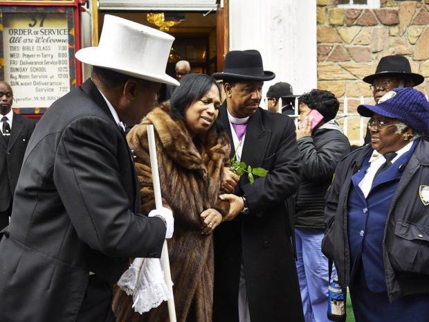 Deborah (left) and William Sutton, parents of Angelikque Sutton at her funeral.jpg