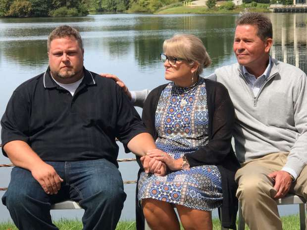 Tyler Tessier sits with Gwen and Mark Wallen during a press conference on Monday, Sept. 11,on missing teacher Laura Wallen