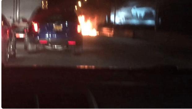 Saeed Ahmad's burning car.png