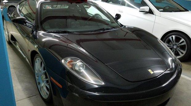 Feds seized high end vehicles during Thursday's arrest of Richard Scott who is suspected of defraudingVeteransAffairsof $11 Million 1.jpg