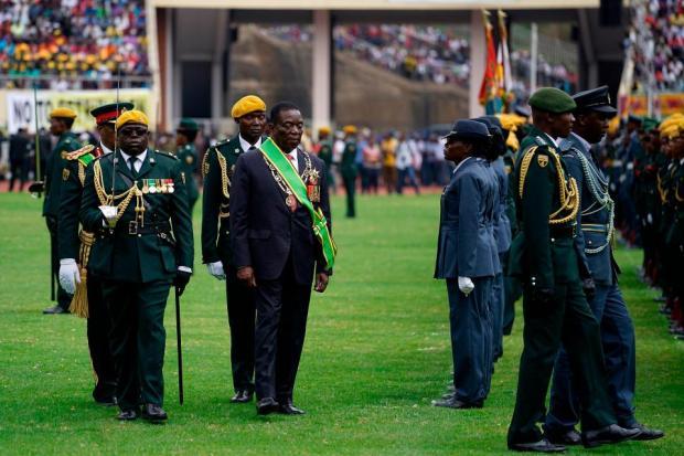 President Emmerson Mnangagwa walks after taking the oath of office.jpg