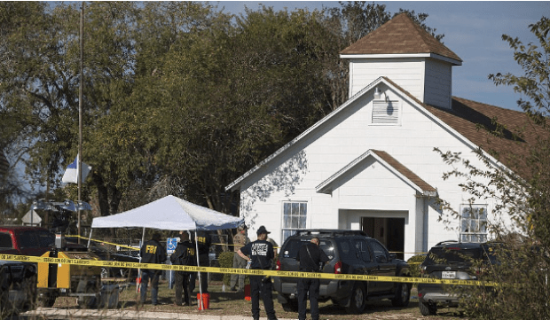 Police and FBI sealthe First Baptist Church of Sutherland Springs with crime scene tape after Suhday's shooting.png
