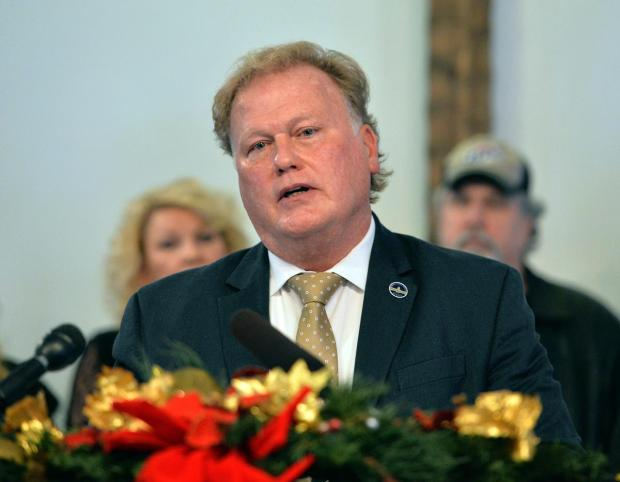 Dan Johnson addresses the public from his church in Louisville on Tuesday.