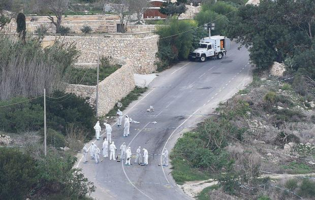 Forensic police work on the main road in Bidnija, Malta, which leads to Daphne Caruana Galizia's house 2.jpg