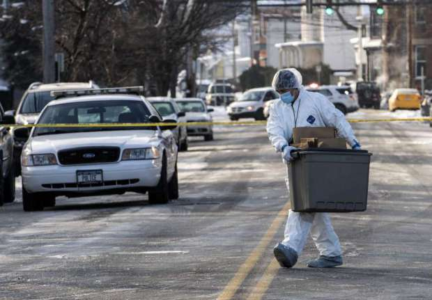 Forensics take out evidence in Troy quaderple homicide.jpg
