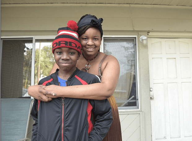 Gregory Jean, Jr., with his sister Tracy Guervil in Orlando, Fla