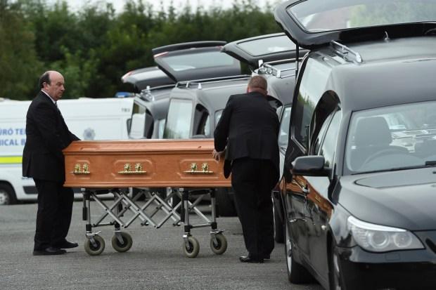 Hawe familys-remains-taken-out-in-coffins1.jpg
