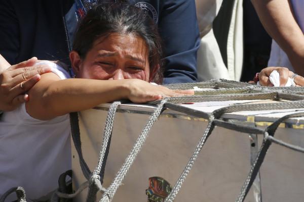 Joanna Daniela Demafelis' sister Jessica weeps over her casket.jpg