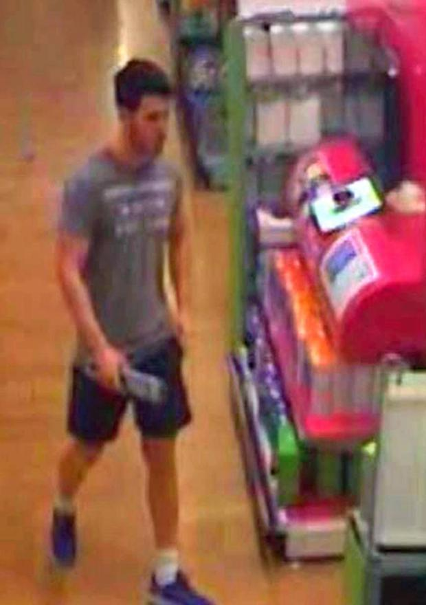 Joshua Stimpson caught on store surveillance camera buying knife.jpg