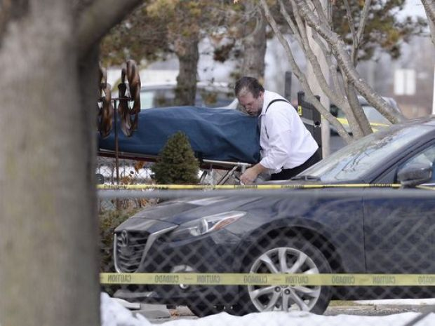 One of four bodies is removed from the Stuart family home at Keego Harbor on Fridat.jpg