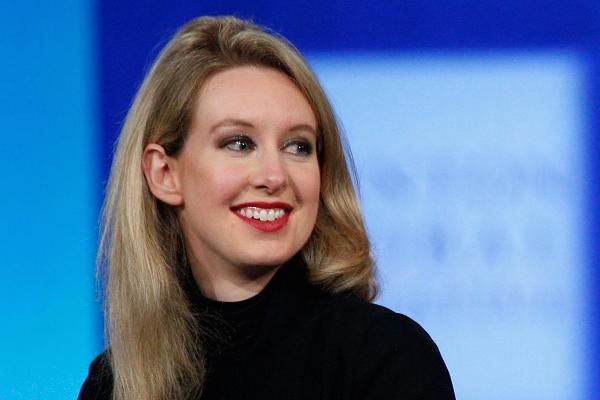 Theranos CEO Elizabeth Holmes surrenders control of the company and gives up most equity after SEC charges her with 'elaborate, years-long fraud' of $750M