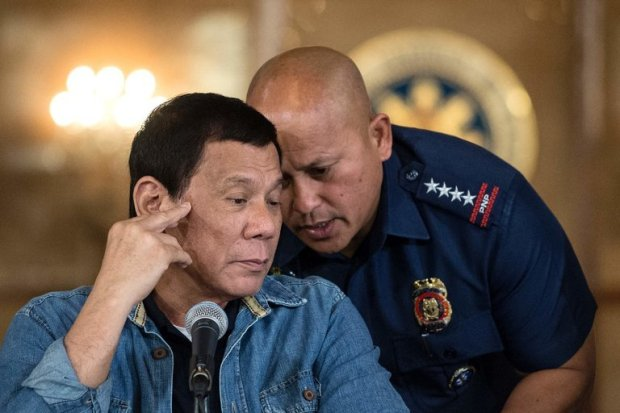 President Rodrigo Duterte [left], with Ronald dela Rosa, the national police chief, during a news conference in the capital Manila in 2017.jpg