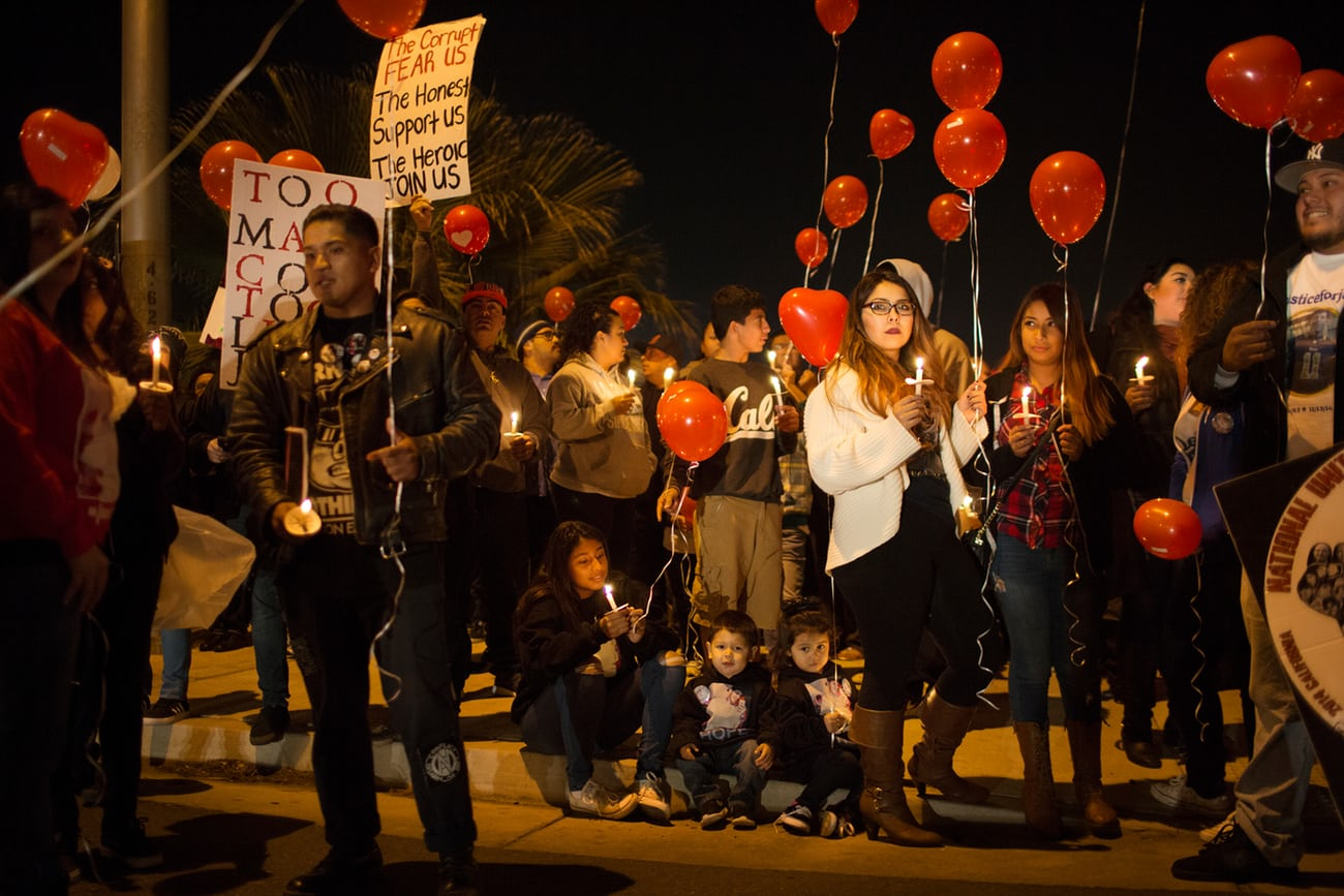 Family and friends mourn James de La Rosa who was shot to death by four police officers, while unarmed in 2014