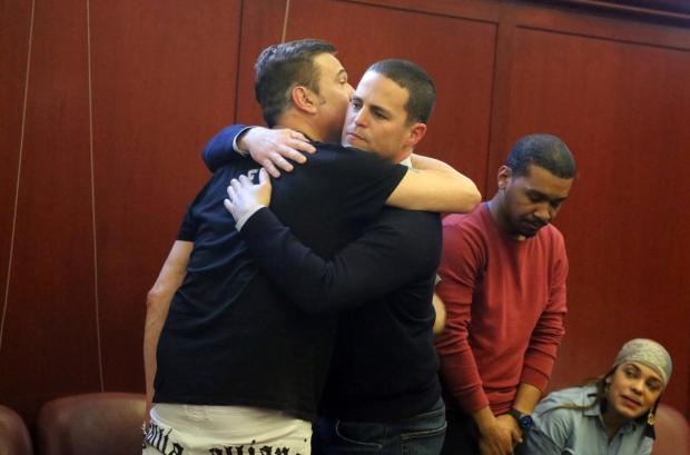 Kevin Krim (r.), the father of the two children murdered by nanny Yoselyn Ortega, hugs a juror after the verdict onWednesday.