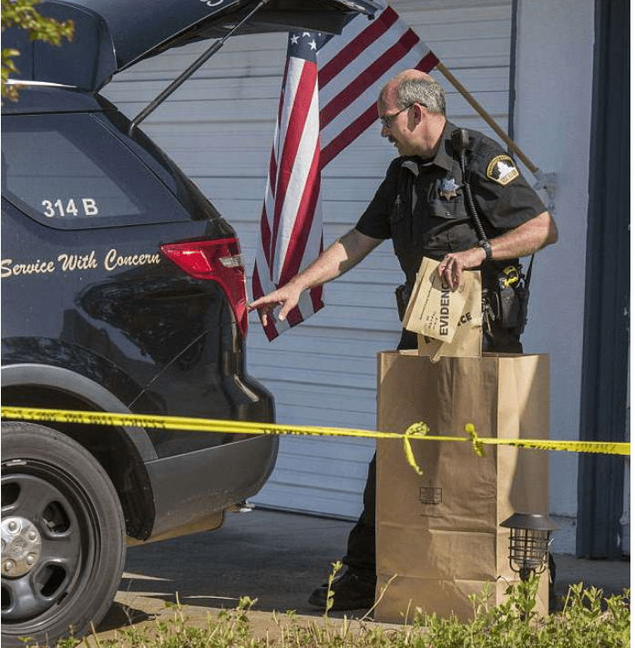 Cops remove evidence from the home of Golden State Killer 2