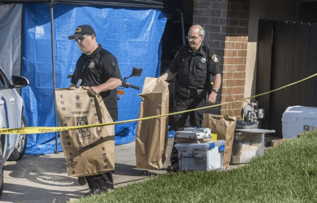 Police take bags of evidence from the James DeAngelo's home 1.png