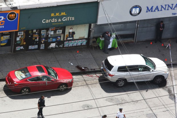 Bloody street scene after Thursday's shooting in the Bronx.jpg