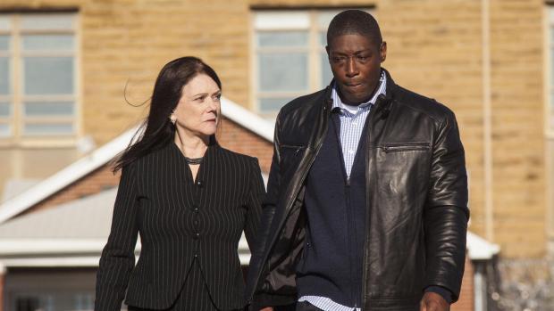 Darryl Fulton, right, walks with his lawyer Kathleen Zellner - Copy